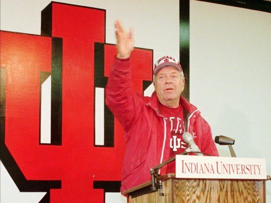 Indiana University football coach Bill Mallory waves