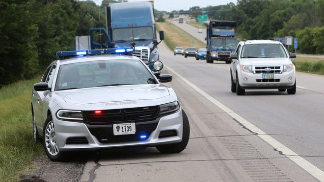 """Ohio Highway Patrol Trooper Dwayne Shephard watches for motorists violating the """"Move Over"""" law on U.S. Route 30 in Perry Township on Wednesday. The Highway Patrol and state police in five other states are participating in an initiative focusing on enforcement of the law as well as public education. The special enforcement period ends Saturday."""