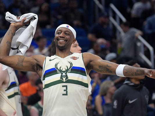 "FILE - In this Feb. 10, 2018, file photo, Milwaukee Bucks guard Jason Terry (3) celebrates after a score by teammate Giannis Antetokounmpo during the second half of an NBA basketball game against the Orlando Magic, in Orlando, Fla. At age 40, Terry still averages about 11 minutes a game in his 19th NBA season. He might be a step slower from the days when he was popping 3-pointers in Atlanta and Dallas. But a player nicknamed ""Jet"" can still most definitely take off on the court. (AP Photo/Phelan M. Ebenhack, File)"