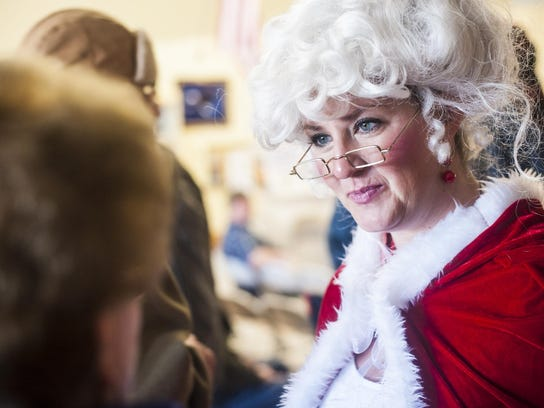 Brianne Sinnott helps seat visitors while dressed as Mrs. Claus during a previous Danny Berg Memorial Dinner at the Great Falls Senior Center.