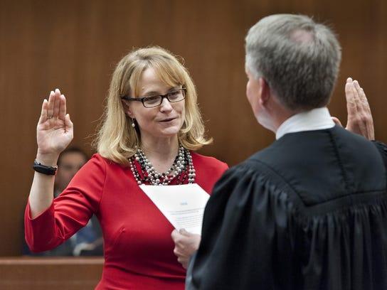 Judge Tara K. Howard takes the oath of office publicly
