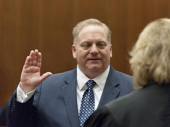 Judge Anthony Fultz takes the oath of office from Tulare