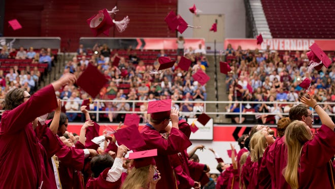 Cheatham County Central graduates throw their caps after being congratulated as the class of 2017.