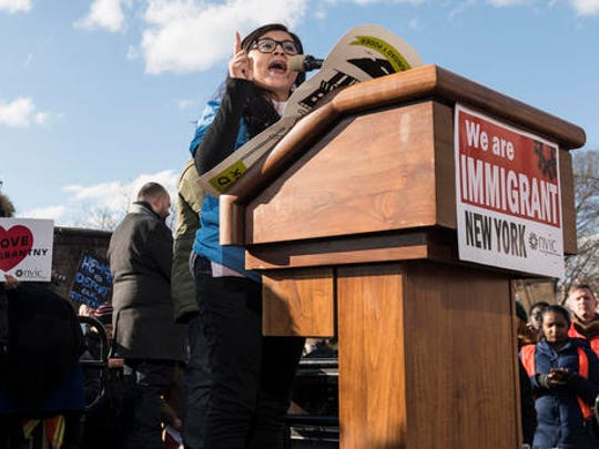 In this Jan. 29, 2017 photo provided by Paul Takeuchi, Yatziri Tovar speaks during a rally in New York's Battery Park, protesting President Donald Trump's temporary suspension of immigration from seven Muslim-majority countries. The 24-year-old college student, who emigrated from Mexico as a toddler, said though she was troubled by the initial days of the Trump administration, she was encouraged to see the activism it has spurred and the people of many backgrounds who have spoken against some of his policies.