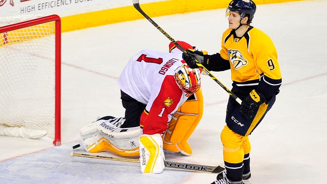 Predators center Filip Forsberg (9) scores the winning goal on Panthers goalie Roberto Luongo in a shootout Saturday.