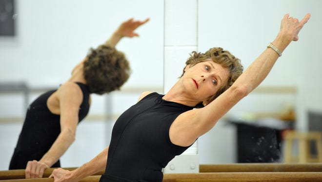 """Kay Martin, 68, warms up before an adult ballet class at the Mississippi Arts Center in Jackson. Her instructor, Cherri Barnett, she says, """"makes it comfortable for any ability."""""""