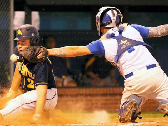Greencastle-Antrim's Matt Kline (23) is safe at home as Lampeter-Strasburg catcher Devon Wient (1) drops the ball during the fourth inning on Monday. Greencastle scored three runs in the fourth to come out on top, 4-2, in a rain-shortened five-inning game.