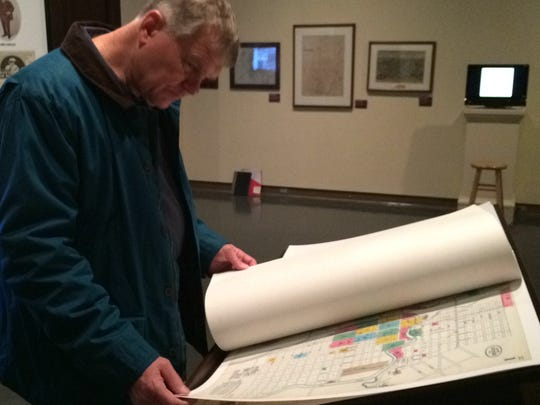 Dale Kramer of Green Bay looks over old insurance maps of the downtown.