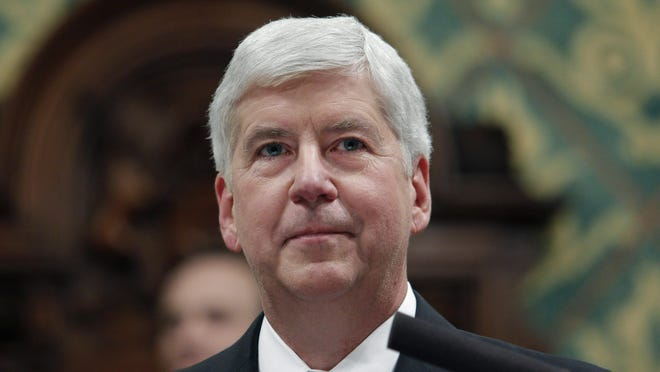 In this Jan. 23, 2018, file photo, former Michigan Gov. Rick Snyder delivers his State of the State address at the state Capitol in Lansing, Mich. Former Gov. Snyder, Nick Lyon, former director of the Michigan Department of Health and Human Services, and other ex-officials have been told they're being charged after a new investigation of the Flint water scandal, which devastated the majority Black city with lead-contaminated water and was blamed for a deadly outbreak of Legionnaires' disease in 2014-15, The Associated Press has learned.