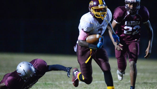 Washington's Travelle Jones (3) carries the ball against Nandua during their game in Onley, Va. on Friday, Oct. 3, 2014. Washington won the game 14-6.