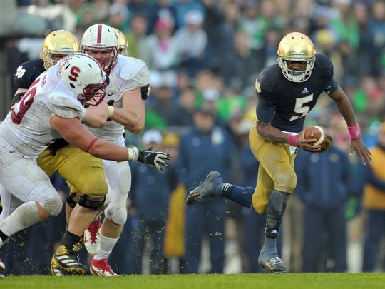 Notre Dame Fighting Irish quarterback Everett Golson (5) runs the ball vs. Stanford.