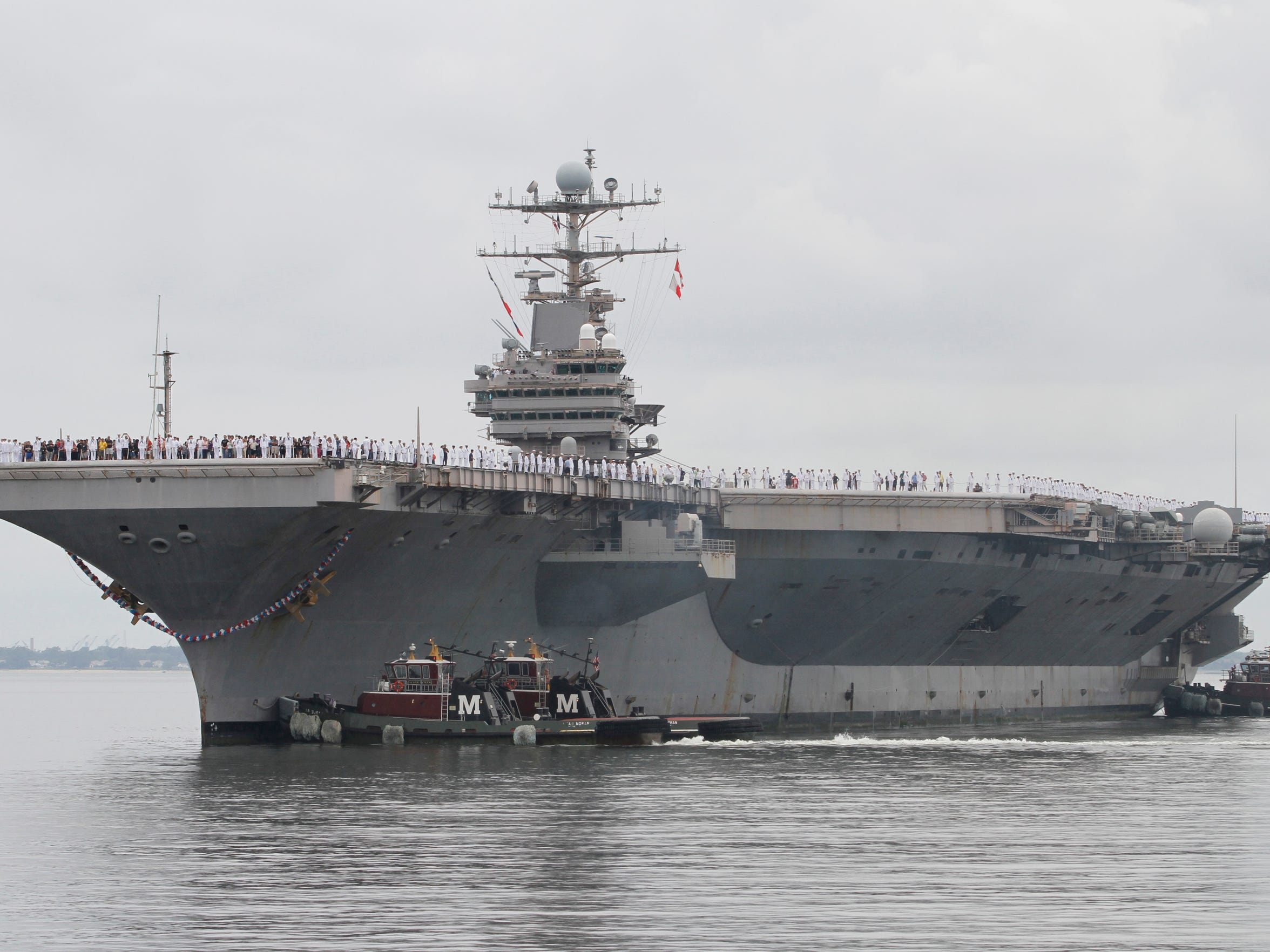 The nuclear-powered aircraft carrier Abraham Lincoln arrives at Naval Station Norfolk in Norfolk, Va., on Aug. 7, 2012.