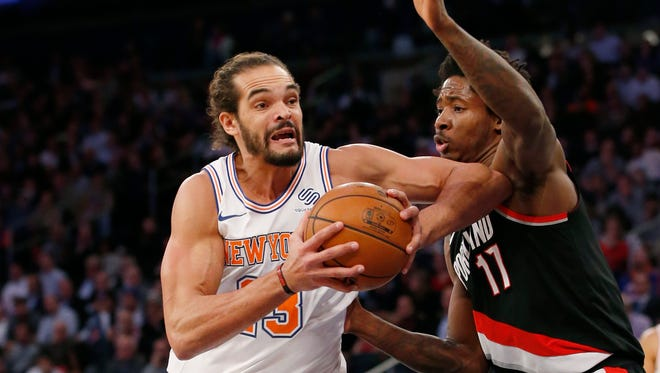 New York Knicks center Joakim Noah (13), making his season debut after a suspension for performance enhancing drugs, goes up against Portland Trail Blazers forward Ed Davis (17) during the Monday's game.