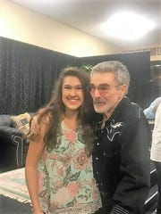 A play written by 18-year-old Christina Karabiyik, pictured with Burt Reynolds, offered Oct. 4-6, is an in-depth look at gun violence from the perspective of those facing the possibility of death.