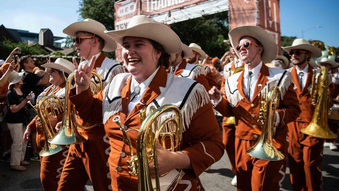 Longhorn Band members march along Bevo Boulevard as fans welcome the team to Royal-Memorial Stadium before the team's game against LSU last September. One FBS program -- UConn -- has announced that its band will be shut down this fall due to the coronavirus pandemic.