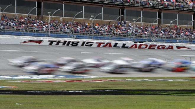 Trucks pass through the tai-oval during the Sugarlands Shine 250 at Talladega Superspeedway, Saturday, Oct 12, 2019, in Talladega, Ala.