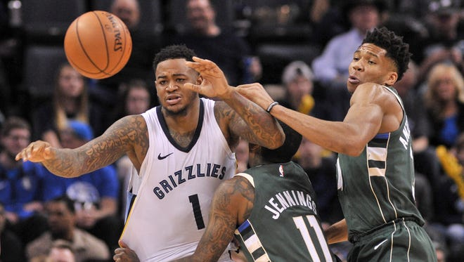 Grizzlies forward Jarell Martin fights for the ball against Brandon Jennings (11) and Giannis Antetokounmpo of the Bucks during the first half Monday.
