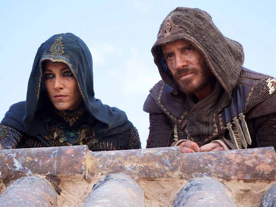 "Marion Cotillard and Michael Fassbender in ""Assassin's Creed."""