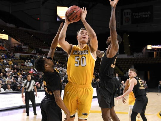 UWM forward Brett Prahl splits two Oakland defenders