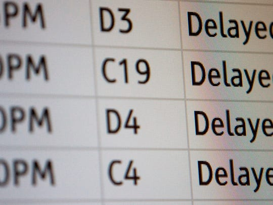 Departing flights are shown as delayed on the flight board at Terminal 4 at Phoenix Sky Harbor International Airport  on Tuesday, December 23, 2008.
