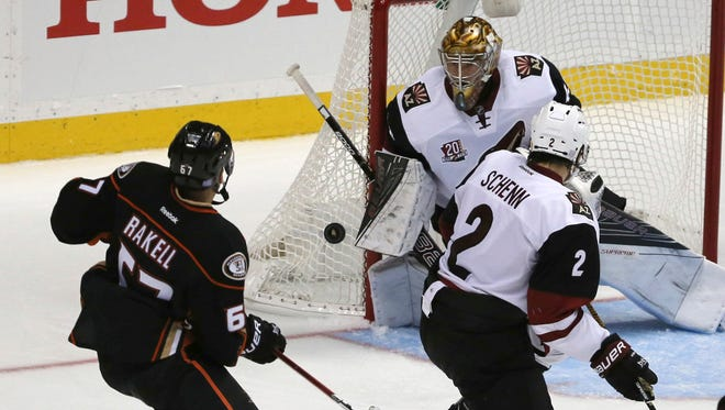 Coyotes goalie Justin Peters (40) deflects the puck as defenseman Luke Schenn (2) and Ducks center Rickard Rakell (67) watch during the second period in Anaheim, Calif., Friday, Nov. 4, 2016. The Ducks won 5-1.
