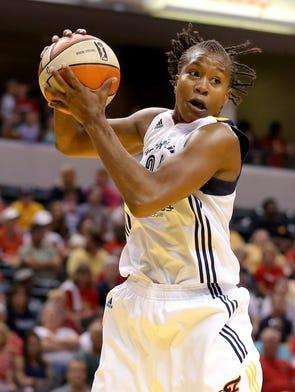 Indiana Fever forward Tamika Catchings grabs one of her 9 rebounds against the Chicago Sky inside Bankers Life Fieldhouse, Thursday, July 17, 2014, in Indianapolis.