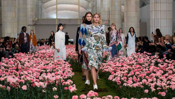 Scenes from Tory Burch's New York Fashion Week show.