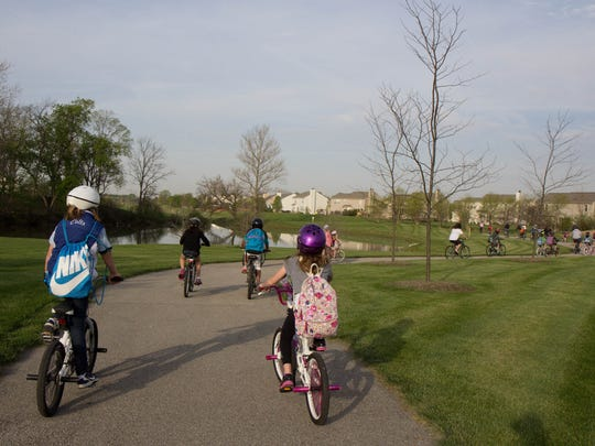 Oak Trace Elementary students ride their bicycles through