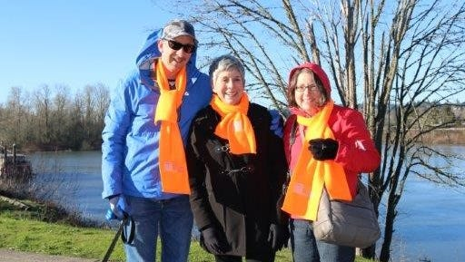 Cross Walk founder Mary Lucas, at center, felt the love Friday morning with Bob Wild, to her left, and Tammy Wild.