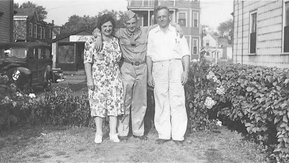 Donald Lindquist (center) with his parents, Elmer and Clara Lundquist, at their Montello Street home in Brockton.