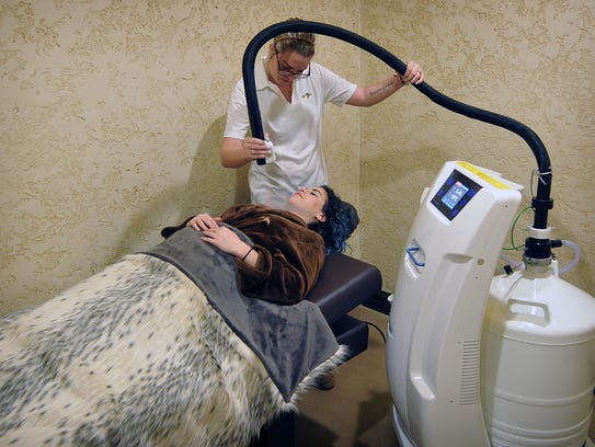 Cryotherapy technician Lainie Steel performs a cryocare