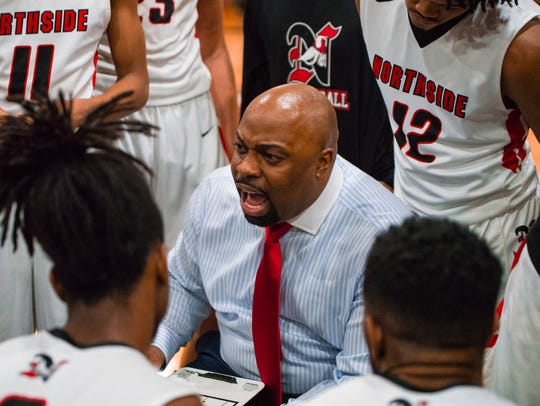 Northside coach Ross Rix barks out instructions during his Vikings' 51-50 win over St. Thomas More on Friday.