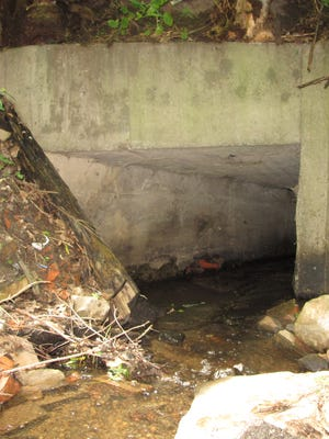 An aging culvert conveys Morehouse Brook beneath Mallets Bay Avenue in Colchester just north of Winooski. Photographed Monday, July 11, 2016.