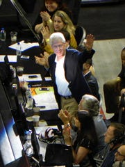 Former President Bill Clinton waves to the crowd at