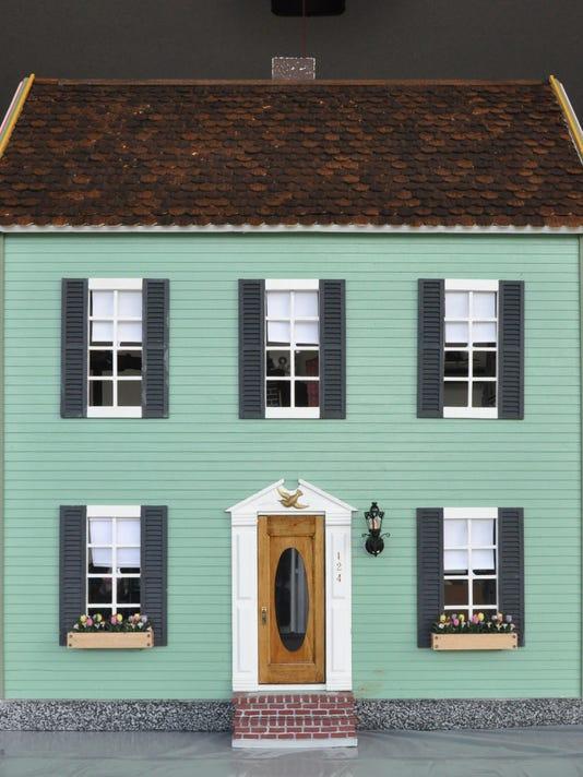 636455524762267004-VNA-front-of-the-restored-dollhouse.jpg