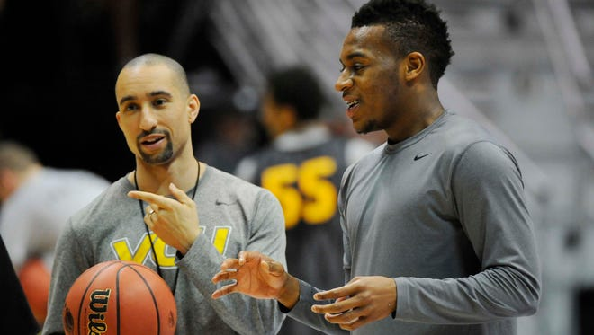VCU Rams player Melvin Johnson (right) stands with head coach Shaka Smart during practice before the second round of the 2014 NCAA Tournament at Viejas Arena.