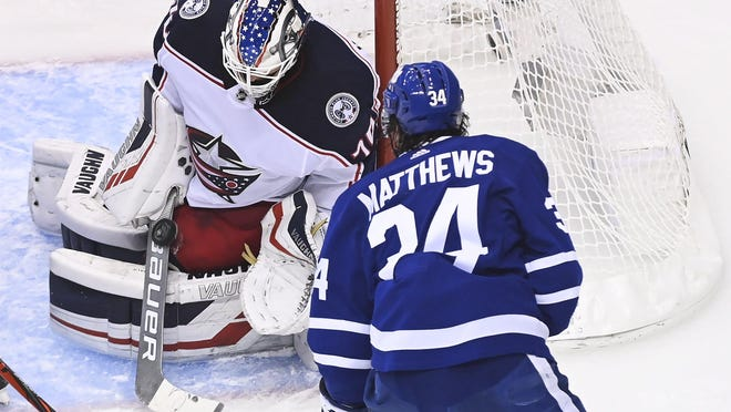 Blue Jackets goaltender Joonas Korpisalo made 28 saves, including this one on Auston Matthews in the second period, in Sunday night's 2-0 victory.