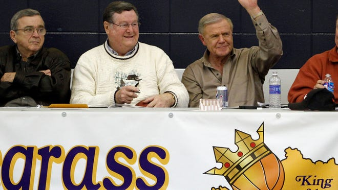 Joe B. Hall, left, and Denny Crum, archrivals in Knoxville in 1983, are buddies now. Here they're schmoozing and snacking at the 2012 King of the Bluegrass tournament.