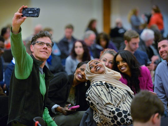 Karl Van Beckum takes a selfie with other participants