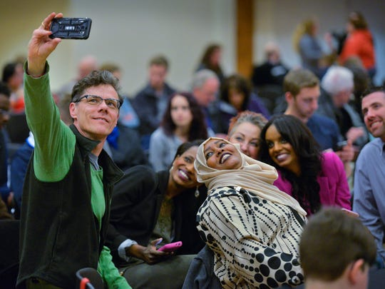 Karl Van Beckum takes a selfie with other participants during Somali Night Saturday at St. Cloud State University. Van Beckum said his wife teaches at SCSU and he wanted to be at the event to support the Somali culture.