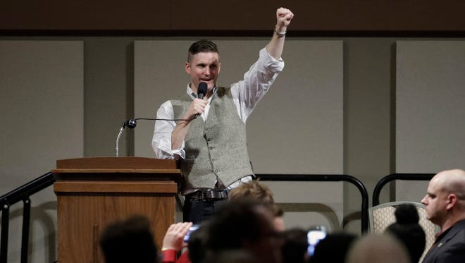 Richard Spencer, who leads a movement that mixes racism, white nationalism and populism, raises his fist as he speaks Dec. 6, 2016, in College Station, Texas.