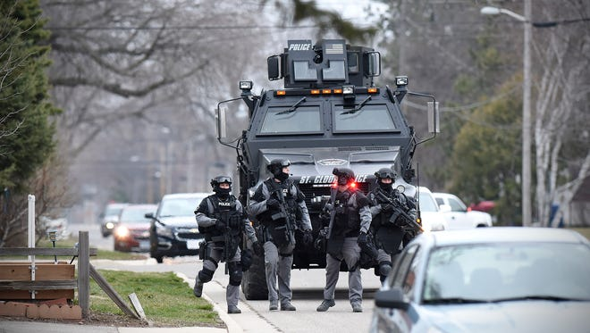 St. Cloud Police Department SWAT team members respond Tuesday to a scene on the 100-block of 28th Ave N in St. Cloud.
