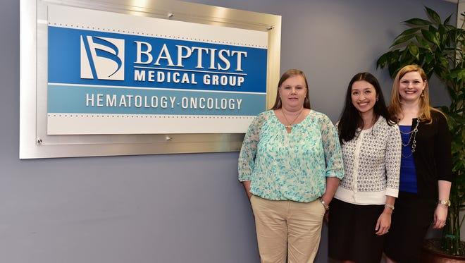 Stephanie Young, Dr. Zhen Topp and Courtney Cook.