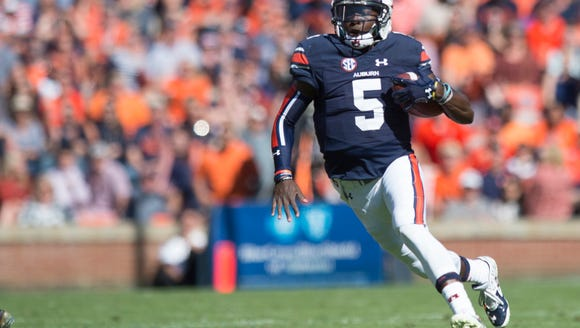 Auburn quarterback John Franklin III (5) runs downfield