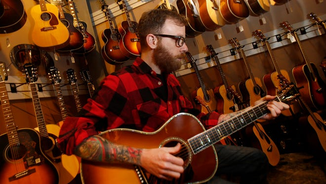 Scott Engel plays a Gibson Montana Limited Edition Nick Lucas Koa Elite ($3299) at Russo Music in Asbury Park Friday, March 24, 2017.