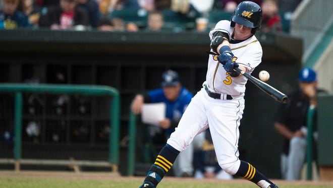 Biscuits third baseman Jake Cronenworth makes contact during the Montgomery Biscuits season home opener against the Biloxi Shuckers on Thursday, April 5, 2018.