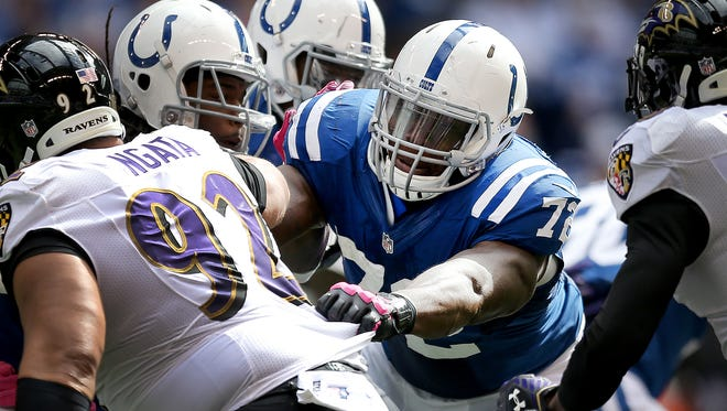 Indianapolis Colts play the Baltimore Ravens Sunday, October 5, 2014, afternoon at Lucas Oil Stadium. Indianapolis Colts Jonotthan Harrison blocks Baltimore Ravens Haloti Ngata on a first half run play.