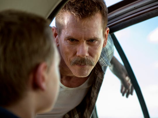 Kevin Bacon is good as a menacing police officer in