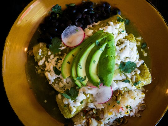 Spicy salsa verde chicken enchilada with avocada, queso sesame seeds, fresh cilantro with rice and beans. Bryan and Andrea Sikora, who own La Fia restaurant, Market Street bakery and the coming soon Merchant Bar on Market Street opens Cocina Lolo on King Street in July.
