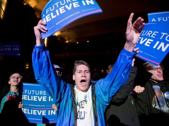 Stephen Bennett of Cape Elizabeth, Maine, cheers at a rally for Democratic presidential candidate Sen. Bernie Sanders, I-Vt., Wednesday, March 2, 2016, in Portland, Maine. (AP Photo/Robert F. Bukaty)